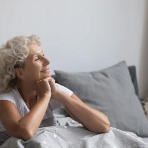 mature women waking up for a good sleep